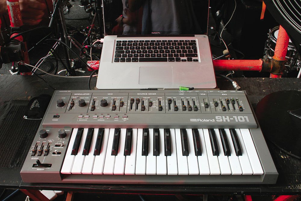 Liam Howlett's keyboard rig includes (clockwise from top left) a vintage Roland SH101 analogue monosynth, Access Virus TI, The invaders machine